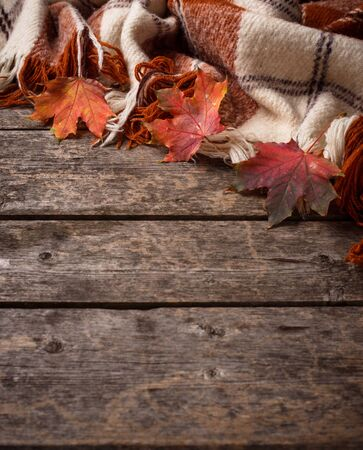 Autumn background with plaid and leaves Reklamní fotografie