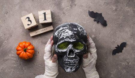 Halloween background with mummy's hand