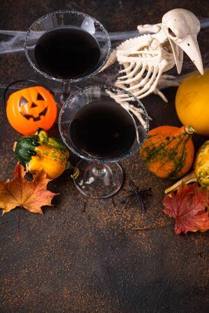 Halloweens spooky drink black martini cocktail