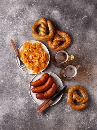 Beer, pretzels, sausages and stewed sauerkraut. Bavarian Oktoberfest food
