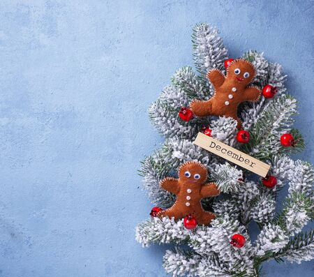 Christmas blue background with gingerbread men made of felt