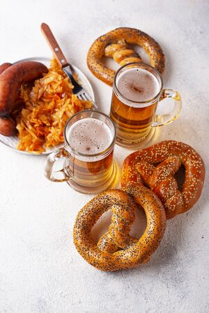 Beer, pretzels, sausages and stewed sauerkraut Stock Photo