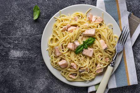 Pasta spaghetti with salmon and basil