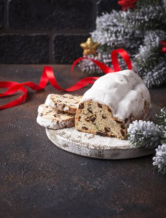 Traditional German Christmas cake stollen with dried fruits Standard-Bild