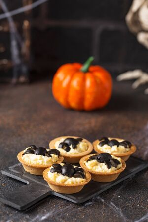 Halloween scary appetizers with cheese salad decorated spiders