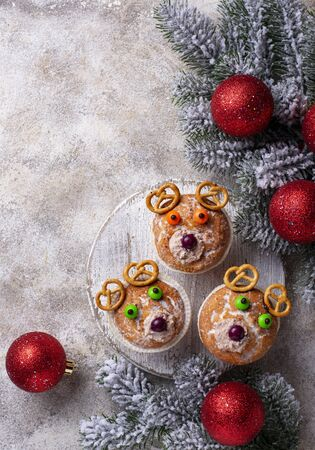 Christmas cupcake in shape of deer or bear. Top view Stock Photo