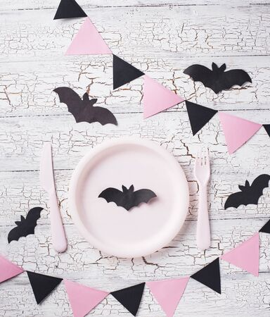 Halloween table setting in black and pink colors