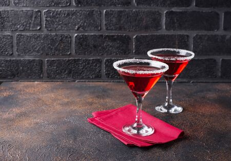 Christmas festive cocktail red martini on dark background