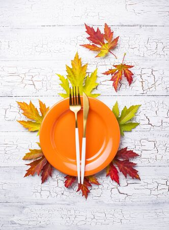 Autumn table setting with leaves