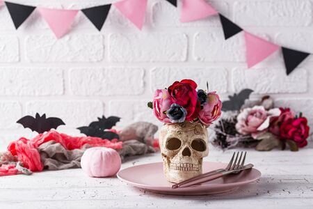 Halloween table setting in pink colors