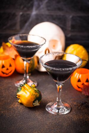 Halloweens spooky drink black martini cocktail