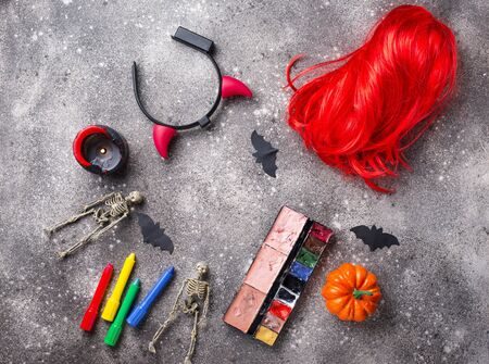 Halloween party accessories. Wigs, candles and face painting