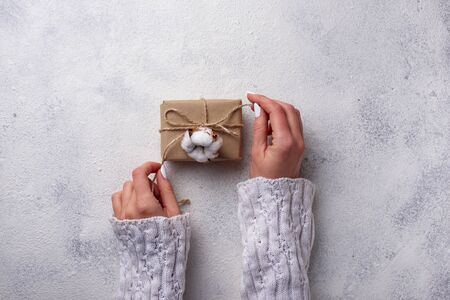 Women hand wrapping gifts boxes in craft paper. Top view Reklamní fotografie