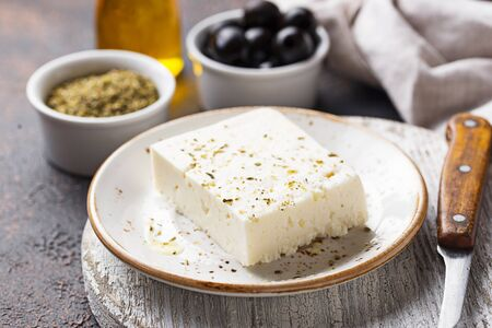 Fresh feta cheese with olive oil and spices Stock fotó