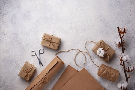 Process of packing gifts boxes in craft paper. Eco zero waste style