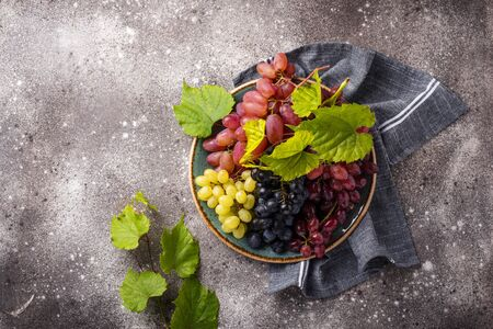 Assortment of different sort of grapes with leaves