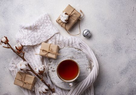 Composition with cotton branch and tea. Flat lay, Instagram style Reklamní fotografie