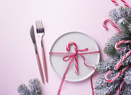 Christmas table setting and pink decor. Top view