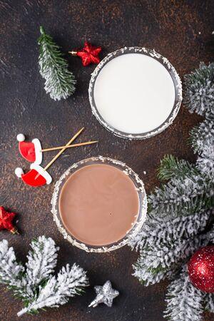 White and dark chocolate snowflake martini cocktail. Christmas drink