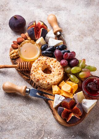 Appetizer for wine, cheese plate with grapes and figs. Food background