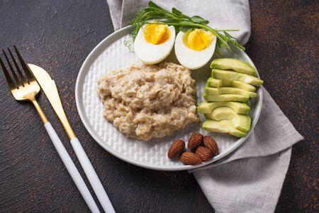 Healthy balanced breakfast. Avocado, oatmeal, eggs and almond Zdjęcie Seryjne