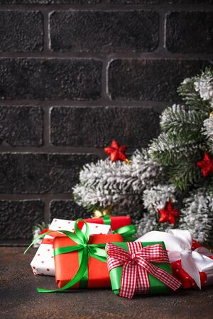 Christmas New Year background with gift boxes in different wrapping