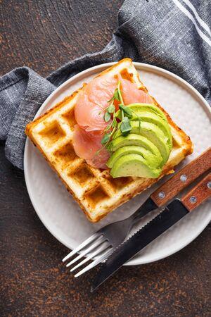 Keto cheese waffle with avocado and salmon