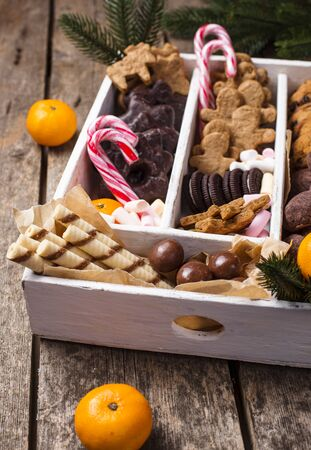 Set of various Christmas cookies in wooden box. Idea for festive gift