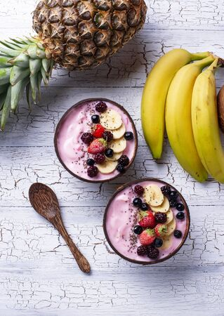 Acai bowl in coconut plate.