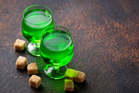 Glasses of absinthe with brown sugar