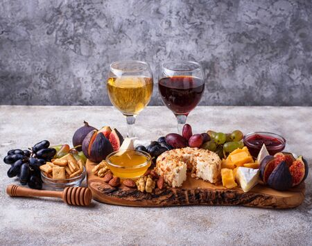 Cheese plate with grapes and wine