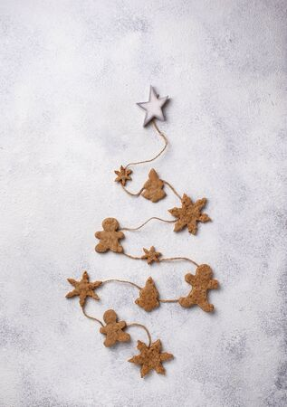 Winter Christmas composition with gingerbread cookies