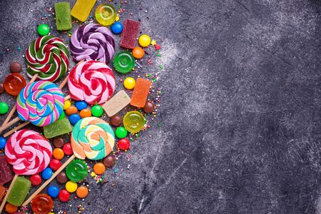 Assortment of colorful candies and lollipops 写真素材