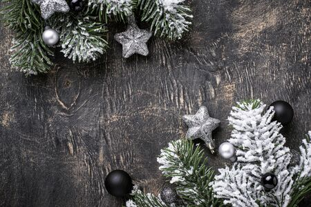 Christmas dark background with branch of tree