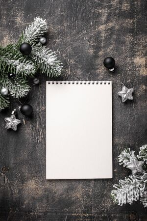 Christmas dark background with notebook
