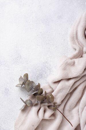 Gray blanket on light background