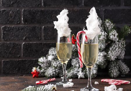 Glasses of champagne or prosecco with cotton candy. Christmas or New year festive drink