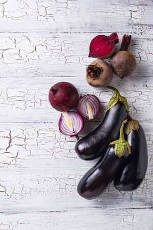 Set of different purple vegetables. Onion, eggplant and beetroot