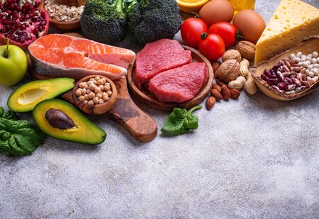 Healthy food and superfood background. Meat, fish, legumes, nuts, seeds, greens, oil and vegetables. Top view, copy space Stock Photo