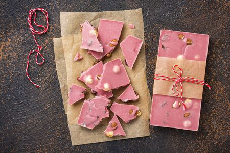 Trendy pink chocolate on rusty table