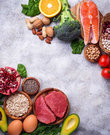 Healthy food and superfood background. Meat, fish, legumes, nuts, seeds, greens, oil and vegetables. Top view, copy space