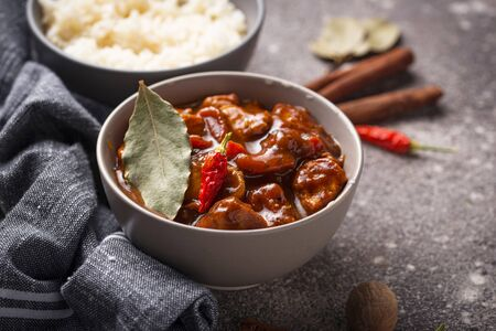 Curry chicken tikka masala with rice and spices
