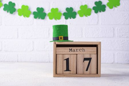 St. Patrick's day background with wooden calendar and leprechaun hat Stock fotó