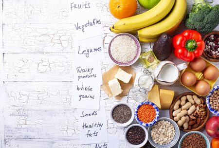 Ovo-lacto vegetarian diet concept. Fruits, vegetables, dairy products, eggs, seeds, healthy fats and grains