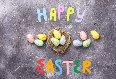 Happy Easter text and color eggs. Festive background