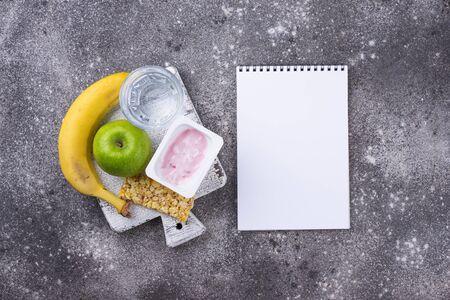 Apple, yogurt, banana and granola bar