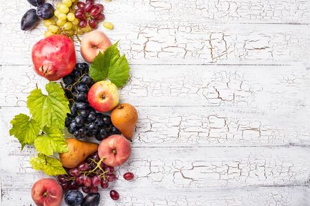 Various autumn fruits. Grapes, apples, pears, peaches and plums. Harvest concept Archivio Fotografico