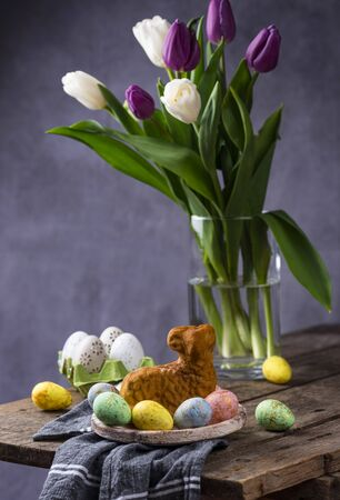 Easter background with tulips and color decorative egg