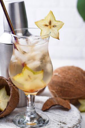 Summer fresh exotic tropical cocktail with carambola