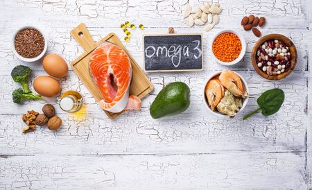 Products sources of Omega-3 acids on wooden table Archivio Fotografico
